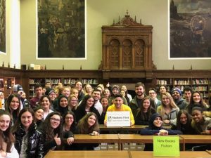 A large group of students from Fordson and Seaholm high schools holding the Dearborn vision sign.
