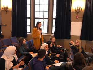Student leading a discussion with students seated in the Fordson auditorium.