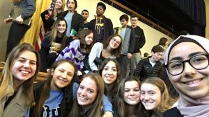 Group of students from Fordson and Seaholm taking a selfie.