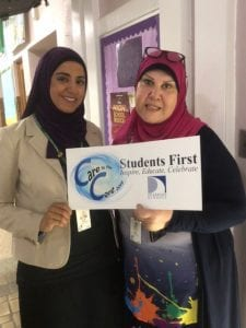 Assistant Principal, Ms. Ahmed , and Parent Liaison, Ms. Dakroub posing with the Care to the Core sign