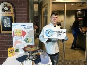 Student serving organic macaroni and cheese.