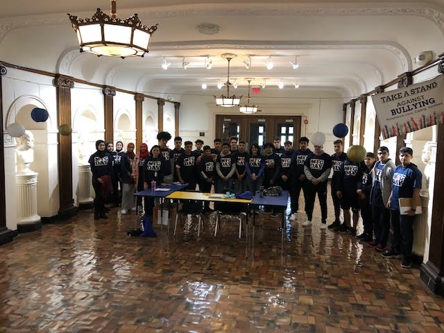 Fordson High School students standing together in the lobby awaiting bus transportation to Henry Ford College Manufacturing Day.